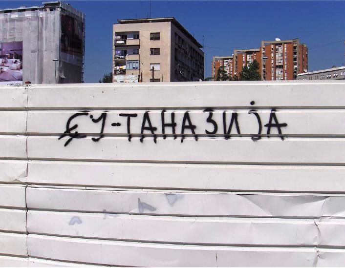 Original graffitti EU-tanesia Public art action,  Skopje, Macedonia, recorded by photographs 10 photographs, each 30x45 cm.  Courtesy by the artist.