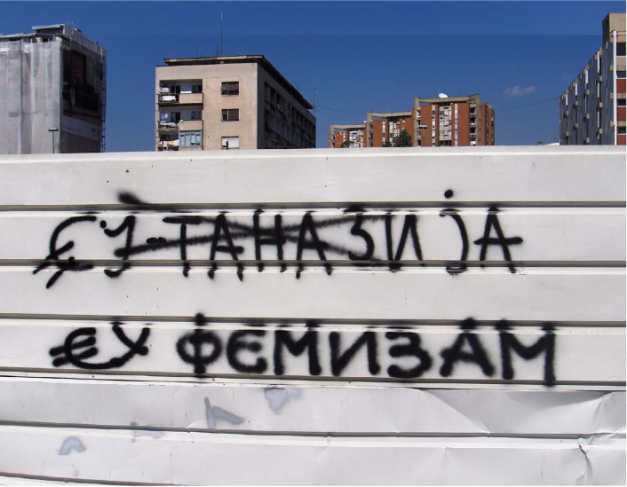 Original graffitti EU-tanesia changed to eu-Phemism Public art action,  Skopje, Macedonia, recorded by photographs 10 photographs, each 30x45 cm.  Courtesy by the artist.
