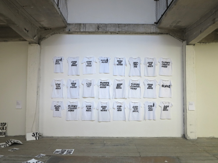 Aliens Inc. 2013 24 shirts, hand painted slogans. 500x400 cm.