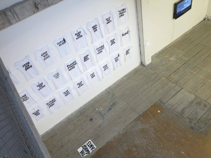 Aliens Inc. 2013 24 shirts, hand painted slogans. 500x400 cm.