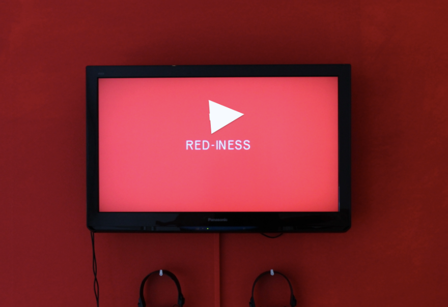 Play an insert from the video Red iness - Gestalt Part of the project 'Subversion to Red' 2013 18 min, colour, loop. Commissioned by Calvert 22, London.
