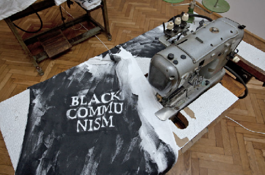 Installation as part of Group exhibition Loophole to happiness at SZTUKI museum, Lodz. Black Communism - 9 shirts, hand painted slogans, old sewing machines. 2010